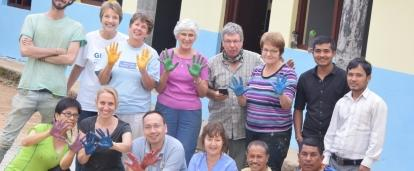 Projects Abroad Childcare volunteers completing voluntary work abroad for over 50s finish up painting work.
